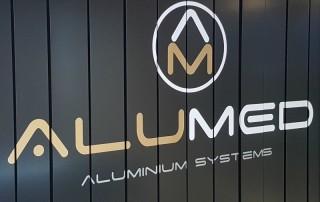 alumed sistemas inauguración exposición carpintería de aluminio ventanas puertas alicante cabecera